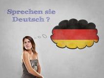 Do you speak German. Girl with flag say Do you speak German Royalty Free Stock Photos