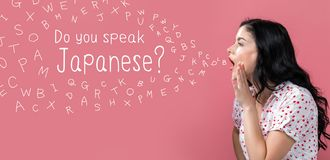 Do you speak Japanese theme with young woman speaking. On a pink background royalty free stock image