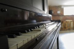 Do you wanna play a song?. This is a 100 years old piano that I discovered in a dirty basement but I fell in love in the minute I saw it, is has so much history Royalty Free Stock Photo