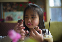 Do you want my cupcake?. One little girl offering her cupcake to her sister Royalty Free Stock Photos