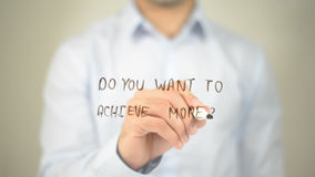 Do You Want To Achieve More , man writing on transparent screen Stock Image
