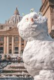 Do You Want to Build a Snowman. A snowman, built by priests and nuns, says hello in St. Peter`s Square of the Vatican Royalty Free Stock Photography