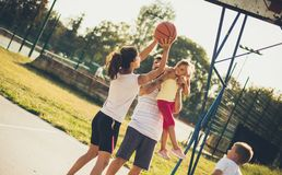 Do your best for your team. Family playing basketball royalty free stock photo