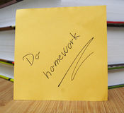 Do your homework. Message on a background with books Stock Photo
