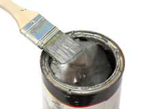 Do it yourself. Brush with fresh paint on a color pot over white Stock Images
