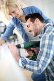 Do-it-yourself activity in new home. Couple installing furniture in new house Stock Image
