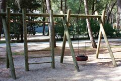 Do-it-yourself children`s playground in the village. Natural eco-friendly materials. Empty playground without children. Ladder an
