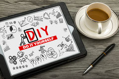 Do it yourself concept hand drawing on tablet pc Stock Images