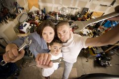 Do-It-Yourself family with wrenches Royalty Free Stock Image