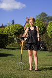 Do It Yourself Gardening Lady. Attractive Rich Woman Tries Her Hand At Being A Do It Yourself Gardener While Standing In Her Front Yard Carrying A Gardening Stock Photos