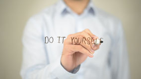 Do it Yourself, Man writing on transparent screen. High quality Royalty Free Stock Photography