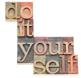 Do it yourself. Popular culture phrase - isolated text in vintage letterpress wood type printing blocks Royalty Free Stock Images