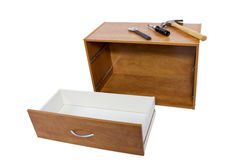 Do-It-yourself Project. Building a shelf or drawer furniture on white background Stock Image