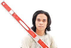 Do It Yourself Projects. Handsome Young Adult With Level For DIY Project stock images
