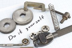 Do it yourself - repair parts. On graph paper background Royalty Free Stock Images