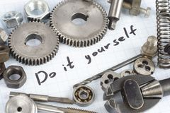 Do it yourself - repair parts. On graph paper background Stock Image