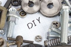 Do it yourself - repair parts. On graph paper background Royalty Free Stock Photo