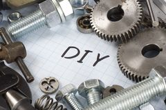 Do it yourself - repair parts. On graph paper background Royalty Free Stock Photography