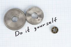 Do it yourself - repair parts. On graph paper background Stock Photography