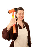 Do-It-Yourself Woman. Pretty woman with shop apron and hammer held aloft Stock Images
