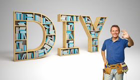Do it yourself. Worker and diy 3d text Royalty Free Stock Images