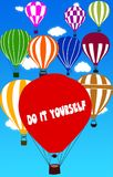 DO IT YOURSELF written on hot air balloon with a blue sky background. Illustration Stock Photography