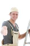 Doação alegre do trabalhador manual polegares acima Imagens de Stock Royalty Free