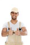 Doação considerável do trabalhador manual polegares acima Foto de Stock Royalty Free