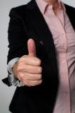 Doação da mulher de negócio polegares acima fotos de stock
