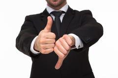 Doação das mãos de Businessman polegares para cima e para baixo o close-up fotos de stock royalty free