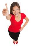A doação feliz da mulher os polegares levanta o gesto Foto de Stock