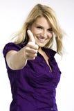 A doação feliz da mulher os polegares levanta o sinal Imagem de Stock
