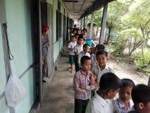 Doação na escola Foto de Stock Royalty Free
