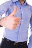 Doação do homem de negócio polegares acima. foto de stock