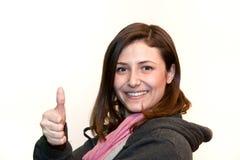 Doação segura da jovem mulher polegares acima Fotografia de Stock