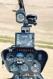 Cockpit of Robinson R44 helicopter during flying. DOBANOVCI, SERBIA - AUGUST 26, 2017: Cockpit of Robinson R44 helicopter during flying, operated by Balkan Stock Photos
