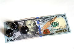 Dobbel en bankbiljet Stock Fotografie