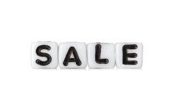 Dobbelt met brieven vormt woord: verkoop Stock Fotografie