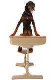 Doberman Puppy in School Desk Stock Image
