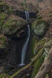 Dobeticky waterfall in dark winter forest. Near Usti nad Labem city Stock Images