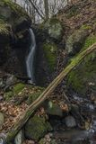 Dobeticky waterfall in dark winter forest. Near Usti nad Labem city Royalty Free Stock Images