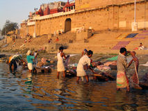 Dobhi in the Ganges. Washing clothes at Raja Ghat, Varanasi, in the holy river Ganages Royalty Free Stock Photography