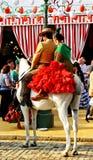 Dobiera się jazdę w Seville jarmarku, Andalusia, Hiszpania Obrazy Royalty Free