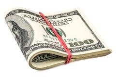 Doblado cientos billetes de dólar Fotografía de archivo libre de regalías