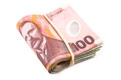 Doblado cientos billetes de dólar Imagen de archivo libre de regalías