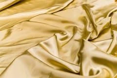 Dobleces arrugados u ondulados del fondo abstracto de la textura de la tela Imagenes de archivo