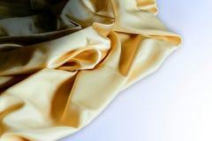 Dobleces arrugados u ondulados del fondo abstracto de la textura de la tela Imágenes de archivo libres de regalías