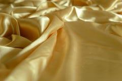 Dobleces arrugados u ondulados del fondo abstracto de la textura de la tela Fotos de archivo libres de regalías