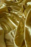 Dobleces arrugados u ondulados del fondo abstracto de la textura de la tela Imagen de archivo