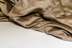 Dobleces de la manta en la superficie blanca Imagenes de archivo